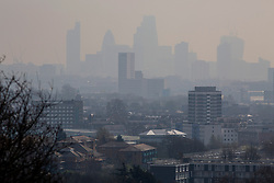 © licensed to London News Pictures. London, UK 01/04/2014. A foggy landscape of London is seen in Hampstead Heath on Tuesday, 1 April 2014 as The Met Office has forecast one of the year's worst smogs in London this week, following a combination of strong winds and powerful dust storms. Photo credit: Tolga Akmen/LNP