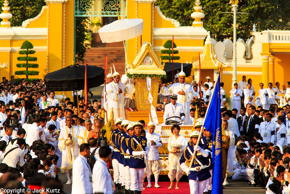 "01 FEBRUARY 2013 - PHNOM PENH, CAMBODIA: The coffin bearing former King Norodom Sihanouk leaves the Royal Palace in Phnom Penh during the funeral procession for the King. Norodom Sihanouk (31 October 1922 - 15 October 2012) was the King of Cambodia from 1941 to 1955 and again from 1993 to 2004. He was the effective ruler of Cambodia from 1953 to 1970. After his second abdication in 2004, he was given the honorific of ""The King-Father of Cambodia."" Sihanouk died in Beijing, China, where he was receiving medical care, on Oct. 15, 2012. His cremation is will be on Feb. 4, 2013. Over a million people are expected to attend the service.    PHOTO BY JACK KURTZ"