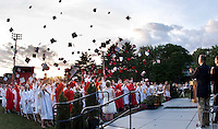 The Laconia High School 2011 graduating class toss their mortar boards in the air following the 133rd commencement celebration Friday evening.  (Karen Bobotas/for the Laconia Daily Sun)Laconia High School commencement ceremony June 10, 2011.