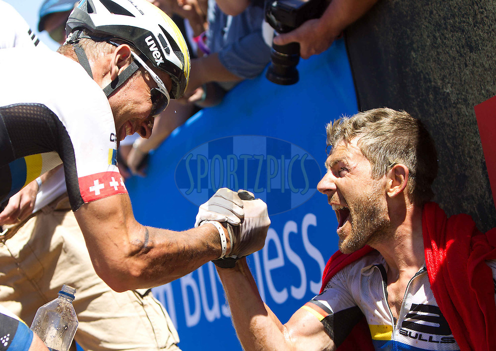 Urs Huber and Karl Platt of the Bulls celebrate after winning stage 2 during stage 2 of the 2013 Absa Cape Epic Mountain Bike stage race from Citrusdal to Saronsberg Wine Estate in Tulbagh, South Africa on the 19 March 2013..Photo by Karin Schermbrucker/Cape Epic/SPORTZPICS
