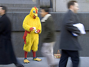 street advertising person dressed as a chicken handing out flyers