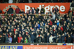 STOKE-ON-TRENT, ENGLAND - Boxing Day Wednesday, December 26, 2012: Liverpool supporters celebrate as Luis Alberto Suarez Diaz is finally awarded a penalty during the Premiership match against Stoke City at the Britannia Stadium. (Pic by David Rawcliffe/Propaganda)