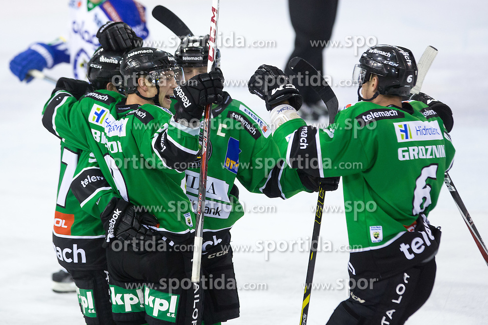 26.09.2014, Hala Tivoli, Ljubljana, SLO, EBEL, HDD Telemach Olimpija Ljubljana vs EC VSV, 5. Runde, in picture Players of HDD Telemach Olimpija celebrate scoring a goal during the Erste Bank Icehockey League 5. Round between HDD Telemach Olimpija Ljubljana and EC VSV at the Hala Tivoli, Ljubljana, Slovenia on 2014/09/26. Photo by Matic Klansek Velej / Sportida