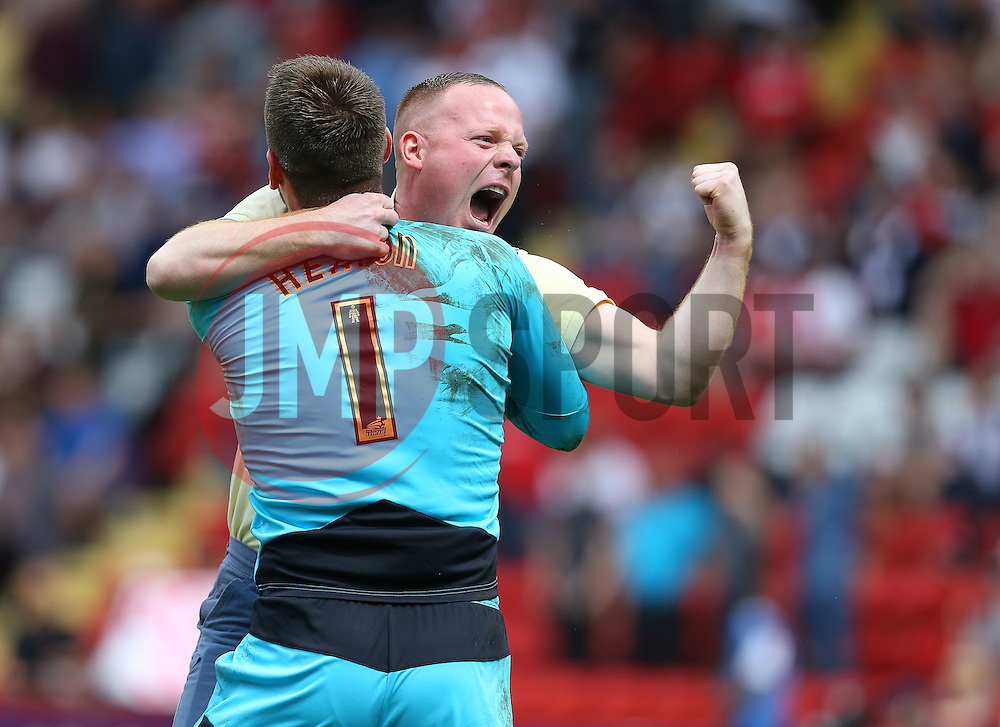 A Burnley fan celebrates with Thomas Heaton of Burnley after the final whistle - Mandatory by-line: Paul Terry/JMP - 07/05/2016 - FOOTBALL - The Valley - London, England - Charlton Athletic v Burnley - Sky Bet Championship