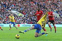 Full stretch for Arsenal's Kieran Gibbs - Photo mandatory by-line: Gary Day/JMP - Tel: Mobile: 07966 386802 30/11/2013 - SPORT - Football - Cardiff - Cardiff City Stadium - Cardiff City v Arsenal - Barclays Premier League