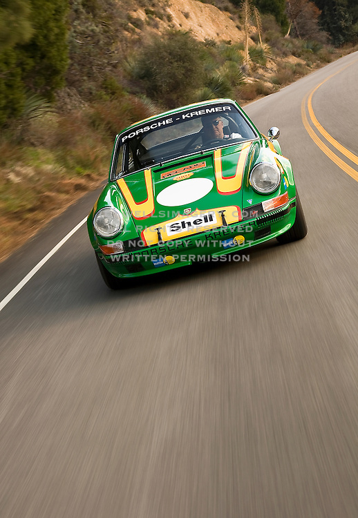 Image of a green sports car in motion, 1972 Porsche 911T/ST Kremer Recreation in California, American west coast, model and property released
