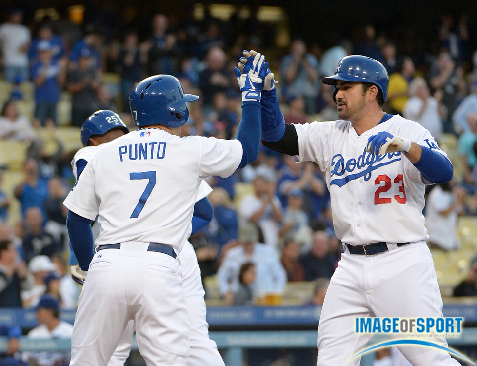 May 10, 2013; Los Angeles, CA, USA; Los Angeles Dodgers first baseman Adrian Gonzalez (23) is greeted by third baseman Nick Punto (7) after hitting a three-run home run in the first inning against the Miami Marlins at Dodger Stadium.