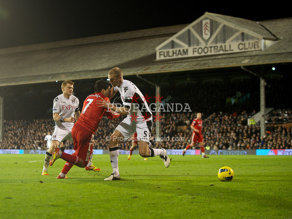 LONDON, ENGLAND - Monday, December 5, 2011: Liverpool's Luis Alberto Suarez Diaz is fouled by Fulham's Brede Hangeland, but no penalty is given, during the Premiership match at Craven Cottage. (Pic by David Rawcliffe/Propaganda)