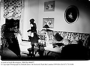 A maid in South Kensington. Home of Count Christophe Gollut. Interior designer. 1980.film 8064f17<br /> © Copyright Photograph by Dafydd Jones<br /> 66 Stockwell Park Rd. London SW9 0DA<br /> Tel 0171 733 0108