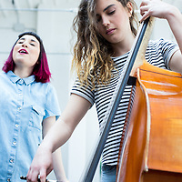 Double Bass player and singer performing together