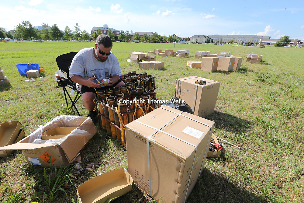 Jermy Stevens a native of Tupelo begins setting up the fireworks for Tuesday's show at the Fairpark. The show which is almost 20 minutes long has over 1,000 shells and costs ver $15,000.