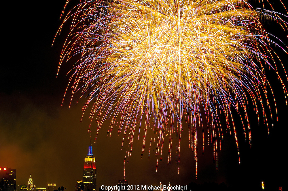 HOBOKEN, NJ - July 04:  Fireworks light up the sky over the Empire State Building in Manhattan part of the Macy's Fireworks 2012 for Independence Day on July 04, 2012 in HOBOKEN, NJ. Communities around the country celebrated Independence Day with parades, summer activities and acts of patriotism. This year marks the 236th anniversary of the United States declaring itself independent from Great Britain. (Photo by Michael Bocchieri/Bocchieri Archive)