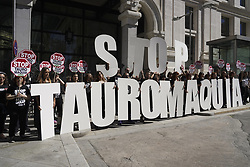 May 12, 2019 - Madrid, Spain - Activists hold signs reading ''Stop bullfighting'' during a protest against bullfighting and animal abuse organised by the animal rights group AnimaNaturalis outside the City Hall in Madrid on May 12, 2019. (Credit Image: © Oscar Gonzalez/NurPhoto via ZUMA Press)