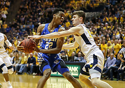 Jan 27, 2018; Morgantown, WV, USA; Kentucky Wildcats guard Shai Gilgeous-Alexander (22) drives down the lane and is guarded by West Virginia Mountaineers guard Chase Harler (14) during the first half at WVU Coliseum. Mandatory Credit: Ben Queen-USA TODAY Sports
