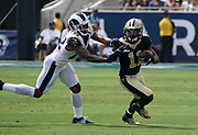 New Orleans Saints wide receiver Deonte Harris (11) runs with the ball while Los Angeles Rams cornerback Marcus Peters (22) defends during an NFL football game, Sunday, Sept. 15, 2019, in Los Angeles. The Rams defeated the Saints 27-9. (Dylan Stewart/Image of Sport)