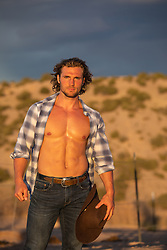 hot cowboy with open shirt at sunset