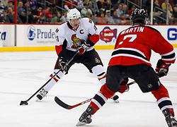 February 13, 2008; Newark, NJ, USA;  Ottawa Senators right wing Daniel Alfredsson (11) skates against New Jersey Devils defenseman Paul Martin (7) during the first period at the Prudential Center in Newark, NJ.