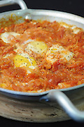 Shakshuka an Israeli dish made of cooked tomatoes, peppers, spices and eggs