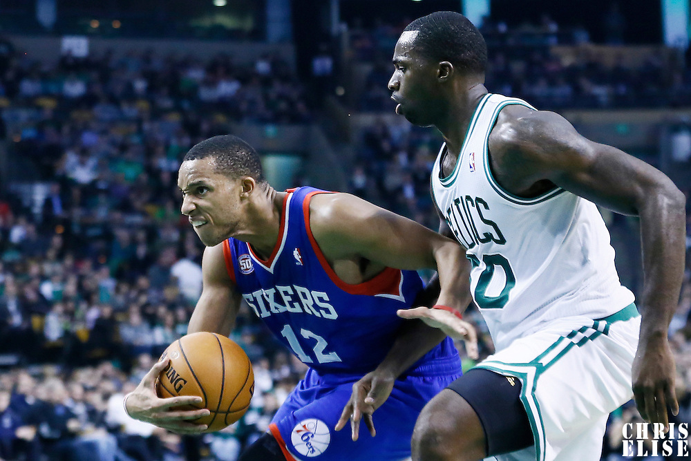 08 December 2012: Philadelphia 76ers small forward Evan Turner (12) drives past Boston Celtics power forward Brandon Bass (30) during the Boston Celtics 92-79 victory over the Philadelphia 76ers at the TD Garden, Boston, Massachusetts, USA.