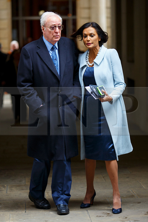 © Licensed to London News Pictures. 05/03/2016. London, UK. MICHAEL CAINE and SHAKIRA CAINE leaving Rupert Murdoch and Jerry Hall's wedding ceremony at St Bride's Church in Fleet Street, London on Saturday, 5 March 2016. Photo credit: Tolga Akmen/LNP