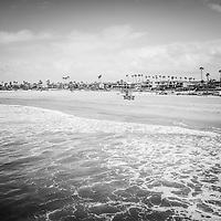 Seal Beach California coastline black and white photo with the Pacific Ocean, lifeguard tower, and oceanfront homes. Seal Beach is in Orange County Southern California in the United States of America.