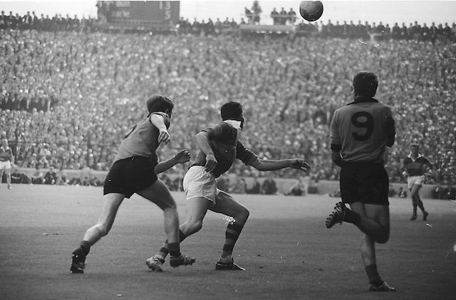 Players run towards the ball during the All Ireland Senior Gaelic Football Final Kerry v Down in Croke Park on the 22nd September 1968. Down 2-12 Kerry 1-13.
