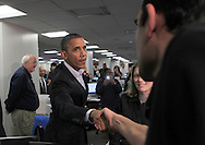 President Barack Obama talks to workers at FEMA Headquarters in Washington, DC on October 28, 2012. Dennis Brack...