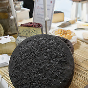A traditional green cheese covered with raisins is displayed at the entrance of one of the stands of the Biennale del Gusto on October 28, 2013 in Venice, Italy. The Biennale del Gusto is an exhibition held over four days, dedicated to traditional food and drinks from all regions of Italy.