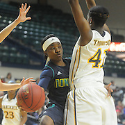 UNCW's Jasmine Steele passes around Drexel's Jamila Thompson Sunday February 1, 2015 at Trask Coliseum on the campus of UNCW. (Jason A. Frizzelle)