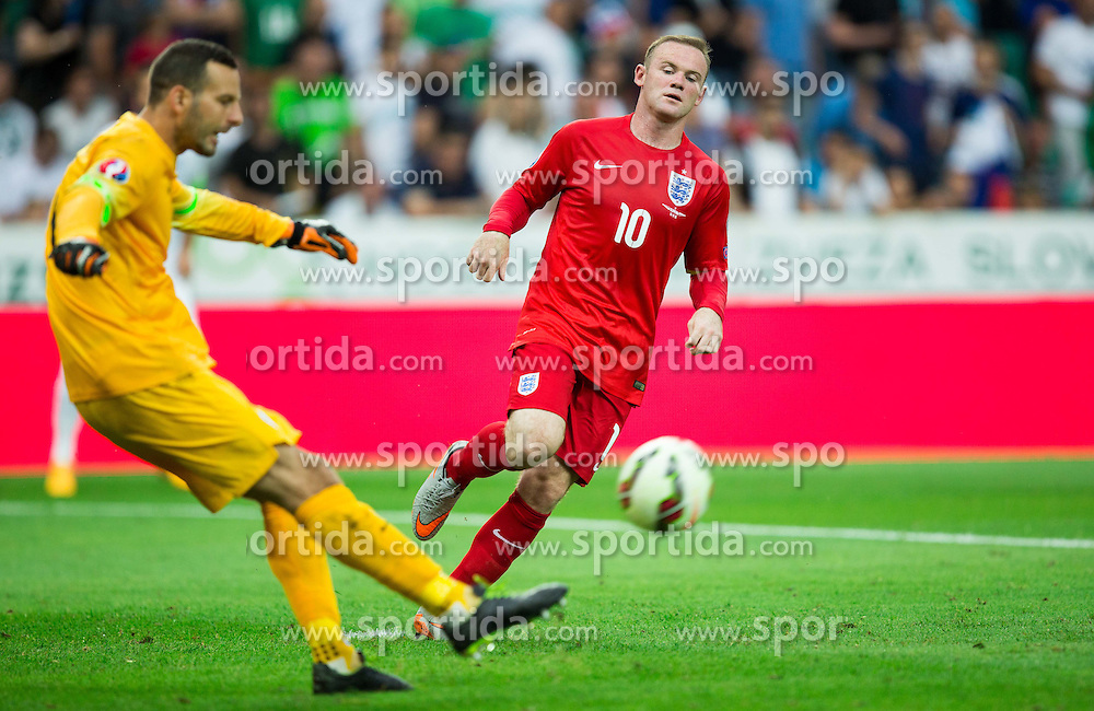Samir Handanovic of Slovenia and Wayne Rooney of England during the EURO 2016 Qualifier Group E match between Slovenia and England at SRC Stozice on June 14, 2015 in Ljubljana, Slovenia. Photo by Vid Ponikvar / Sportida