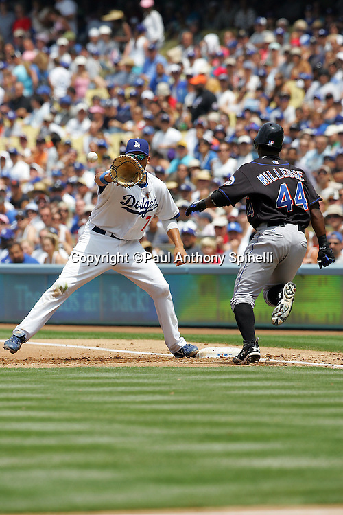 LOS ANGELES, CA - JULY 22:  First baseman James Loney #7 of the Los Angeles Dodgers awaits the throw for a force out on the Mets Lastings Milledge #44 during the game against the New York Mets at Dodger Stadium in Los Angeles, California on July 22, 2007. The Mets defeated the Dodgers 5-4 in ten innings. ©Paul Anthony Spinelli *** Local Caption *** James Loney;Lastings Milledge