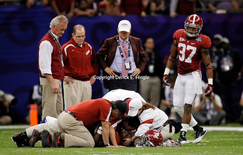 Jan 9, 2012; New Orleans, LA, USA; Alabama Crimson Tide linebacker C.J. Mosley (32) is checked on by trainers and teammates after sustaining an injury during the second half of the 2012 BCS National Championship game against the LSU Tigers at the Mercedes-Benz Superdome.  Mandatory Credit: Derick E. Hingle-US PRESSWIRE