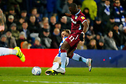 Rangers Midfielder Luke Freeman slides in on Aston Villa's Midfielder Yannick Bolasie during the EFL Sky Bet Championship match between Queens Park Rangers and Aston Villa at the Loftus Road Stadium, London, England on 26 October 2018.