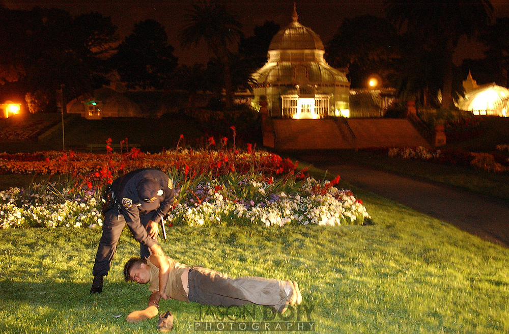 Officer Gabriel Gallaread, tries to wake up an intoxicated 21-year-old that had passed out on the lawn of the Conservatory of Flowers. A medic was called to evaluate his condition...10:45pm 9-10-04