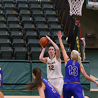 3rd year forward Christina McCusker (12) of the Regina Cougars in action during the Women's Basketball Preseason game on October 14 at Centre for Kinesiology, Health and Sport. Credit: Arthur Ward/Arthur Images