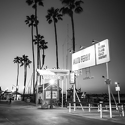 Newport Beach California Balboa Island Auto Ferry sign black and white photo. The auto ferry transports passengers from Balboa Peninsula to Balboa Island in Orange County Southern California. Photo is high resolution. Copyright ⓒ 2017 Paul Velgos with All Rights Reserved.