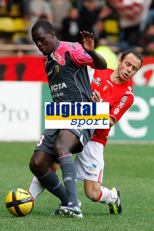 FOOTBALL - FRENCH CHAMPIONSHIP 2010/2011 - L1 - AS MONACO v RC LENS - 15/05/2011 - PHOTO PHILIPPE LAURENSON / DPPI - KANGA AKALE (LEN) / LAURENT BONNART (ASM)