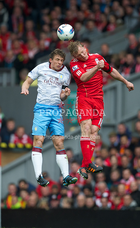 LIVERPOOL, ENGLAND - Saturday, April 7, 2012: Liverpool's Dirk Kuyt and Aston Villa's Stephen Warnock during the Premiership match at Anfield. (Pic by David Rawcliffe/Propaganda)