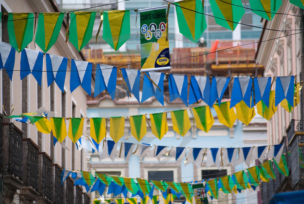 blue, yellow, and green flags hung above the street stream across downtown rio de janeiro, brazil