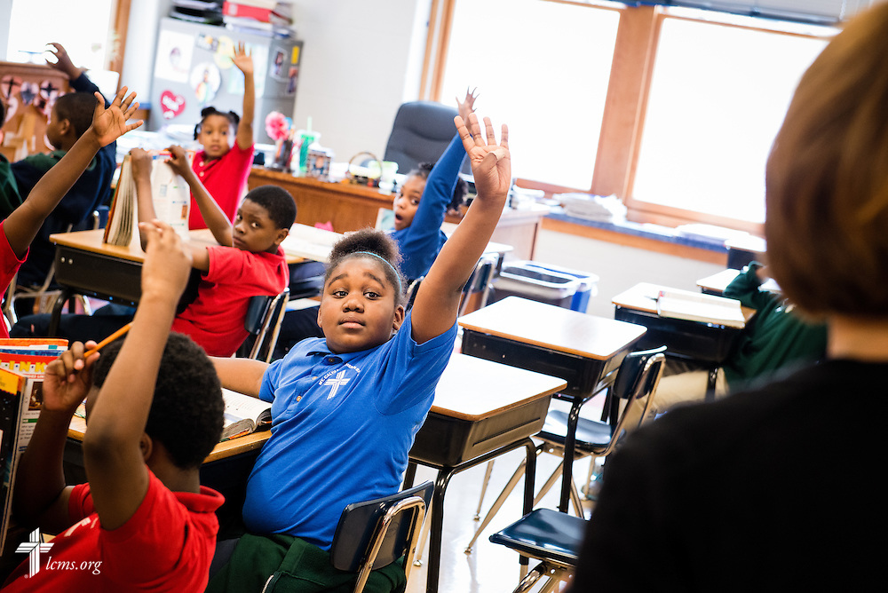 Gia raises her hand in response to a question asked by 3rd grade teacher Sherry Williams during class at Mount Calvary Lutheran School on Wednesday, May 28, 2014, in Milwaukee, Wis. LCMS Communications/Erik M. Lunsford