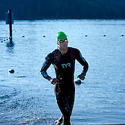 Ben Metcalfe - first swimmer out of the water.  Best in the West Triathlon.  Half Ironman Triathlon at Foster Lake on 10 September 2011, Sweet Home, Oregon.