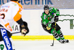 12.02.2015, Hala Tivoli, Ljubljana, SLO, EBEL, HDD Telemach Olimpija Ljubljana vs Moser Medical Graz, 2. Qualification Round, in picture Tadej Snoj (HDD Telemach Olimpija, #21) during the Erste Bank Icehockey League 2. Qualification Round between HDD Telemach Olimpija Ljubljana and Moser Medical Graz 99ers at the Hala Tivoli, Ljubljana, Slovenia on 2015/02/12. Photo by Morgan Kristan / Sportida