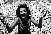 Woman resists on her land already devastated by eucalyptus planting, North Minas Gerais State, Brazil.