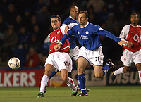 Photo. Matthew Lewis.<br />Leicester City v Arsenal. FA Barclaycard Premiership. 06/12/2003.<br /><br />Arsenal's Edu and Leicester's Riccy Scimeca challenge for the ball.