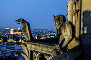 France. Paris elevated view from Notre dame cathedral. Gargoyles ecorate a balcony on the Chimeras gallery of Notre Dame Cathedral in Paris. Viollet-le-Duc restored the cathedral in the mid 1800s.