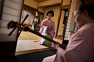 Three trainee geisha, known as 'maiko' until they make their debut appearance, who have been hired and are being trained by the local authorities, undergo their dance and shamisen playing practice, in Shimoda, Japan, on Wednesday 14th December 2011. .The three geisha are Awagiku (in white/silver kimono), Rinka (black kimono), Iroha (pink kimono). Their teachers are Nami (green kimono), Hanamaru (geisha in purple kimono) and their teacher of shamisen musical instrument is Chikako (wearing pink kimono, gold glasses)..The three trainee geisha were selected after applying for the positions which were advertised by Shimoda city council via the 'Hello Work' employment office. The Shimoda city council hope to keep the geisha tradition alive within their town by the appointment of the girls, and the girls will undertake geisha duties at local festivals and for tour groups and tourists.