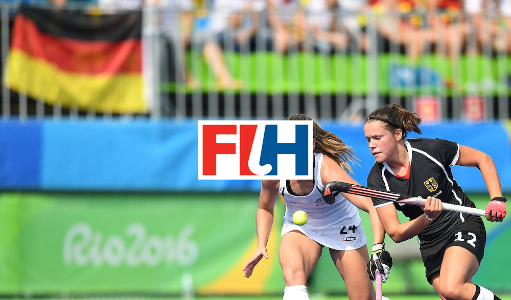 New Zealand's Rose Keddell (L) and Germany's Charlotte Stapenhorst chase the ball during the women's field hockey New Zealand vs Germany match of the Rio 2016 Olympics Games at the Olympic Hockey Centre in Rio de Janeiro on August, 8 2016. / AFP / MANAN VATSYAYANA        (Photo credit should read MANAN VATSYAYANA/AFP/Getty Images)
