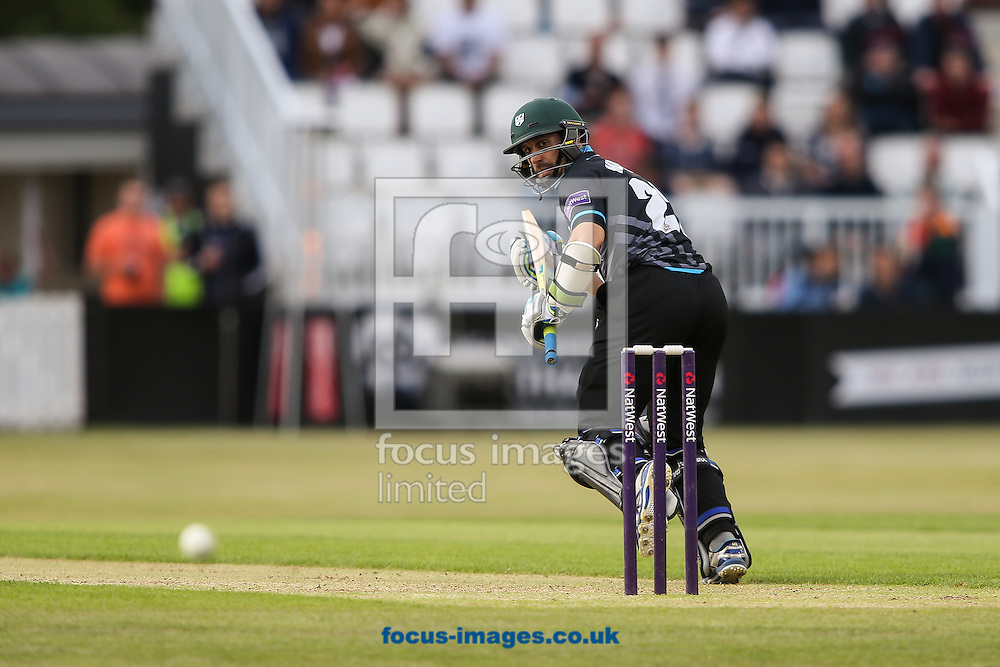 Daryl Mitchell of Worcestershire Rapids hits the ball to the boundary for four during the Natwest T20 Blast match at the County Ground, Northampton<br /> Picture by Andy Kearns/Focus Images Ltd 0781 864 4264<br /> 05/06/2015