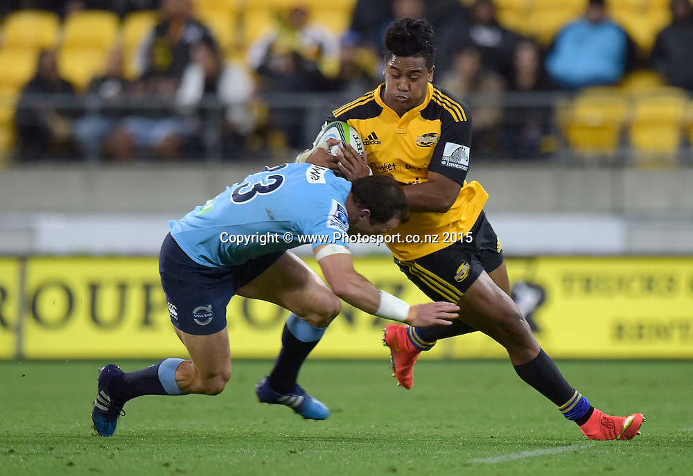 Hurricanes' winger Julian Savea (R is tackled by Waratahs' Matt Carraro during the Super Rugby - Hurricanes v Waratahs rugby union match at the Westpac Stadium in Wellington on Saturday the 18th of April 2015. Photo by Marty Melville / www.Photosport.co.nz