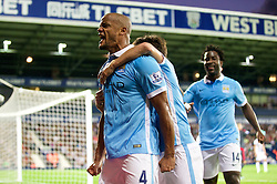 WEST BROMWICH, ENGLAND - Monday, August 10, 2015: Manchester City's captain Vincent Kompany celebrates scoring the third goal against West Bromwich Albion during the Premier League match at the Hawthorns. (Pic by David Rawcliffe/Propaganda)